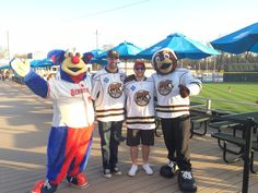 Harrisburg Senators mascot, Rascal, joined Hershey Bears mascot, Coco, and players Dane Byers and Nathan Walker for a photo during Hershey Bears Night at Metro Bank Park on April 13, 2015