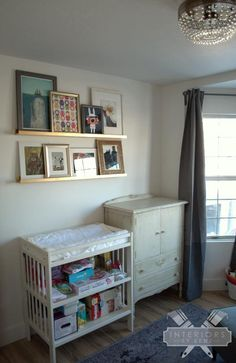 Spray paint IKEA Ribba ledges gold, for an easy gallery wall. (Little girl nursery)