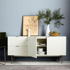 With its geometric, textured front, our retro-inspired Audrey Dining Buffet makes quite an impression. Slim, antique brass-finished metal handles pull the look together. Family Room Design, Dining Room Design, Interior Design Kitchen, Living Room Kitchen, Living Room Decor, Living Rooms, Dining Buffet, Oversized Furniture, Room Planning
