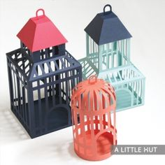 Three charming DIY paper birdcages. Can be used as table decorations, party favor holders, centerpieces or even cake toppers