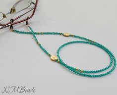 Beaded Emerald Green Crystal Eyeglass Chain Green And Gold Eyeglass Lanyard I designed this eyeglass necklace with emerald green glass faceted crystal beads, gold plated beads and 2 gold plated spacer featuring raised tulip design. For this chain, i used stainless steel beading wire. It has elastic glasses holders with a gold plated coil. Perfect for reading glasses. Simple but chic glasses holder is approximately 28(72cm), lightweight and easy to wear. ♥ All my jewelry comes in a pretty... Faceted Crystal, Crystal Beads, Beaded Jewelry, Beaded Bracelets, Eyeglass Holder, Necklace Holder, Reading Glasses, Handmade Accessories, Emerald Green