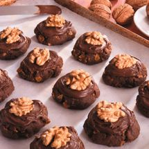 Afghan Biscuits - This recipe produces a wonderfully crunchy, yet delicate cookie made out of cornflakes, and always topped with chocolate icing and walnuts.