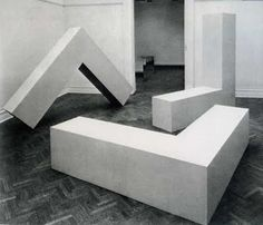 Robert Morris, L-BEAMS 1965 originally plywood, later versions made in fiberglass and stainless steel, 8 x 8 x 2 feet