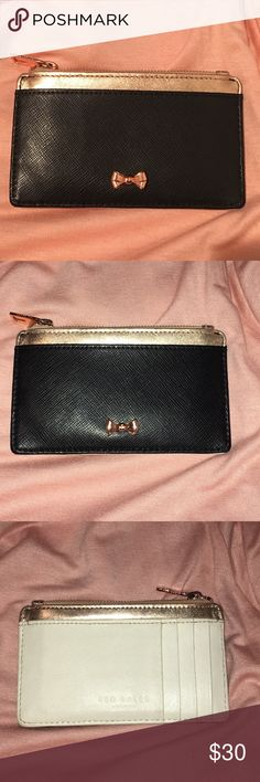 Ted Baker Card/Coin Case Used condition. Used it for about 6 months.  It is black, white and rose gold leather. The bow is rose gold. There is some indentations from credit cards. The white leather has some black spots but not to noticable. Most likely can be cleaned. No discoloration or fading of the metallic leather. Ted Baker London Bags Wallets