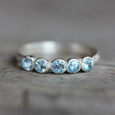 Aquamarine Anniversary Band Ring, Sterling Silver Ring, 5 stone Design in Recycled Sterling and March Birthstone. $228.00, via Etsy.