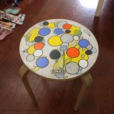 """New hand-painted, upcycled table called """"Turntable Stool"""".  My flatmate found a bunch of abandoned Ikea stools outside the front of the house and brought 3 of them back to be painted...  This is the first one of the 3, and there are 2 more in a similar style on the way...  I called it """"Turntable Stool"""" because I though it look like the deck of a turntable when you're looking down on it as the record spins (I also thought it looked like a washing machine spinning around too!)"""