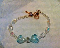 Must be in a blue mood! Blue and silver lampwork glass hearts with crystal by rowdylady, $20.00