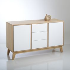 Combining stylish Scandinavian design and practicality, the Jimi sideboard will refresh your lounge or dining room.With a classic Nordic combination of natural wood and crisp white, this sideboard with a solid oak base will keep your room minimal and clutter-free. Complete with 2 doors and 3 drawers, all with a push-opening design, there are many places to store away table linen, plates and bowls or tableware. Sideboard in MDF with an oak veneer2 doors and 3 drawers in MDF with white…