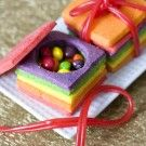 "Surprise Sugar Cookies 'Presents'! Colorful sugar cookies are stacked to create ""presents"" full of candy! Genius!"