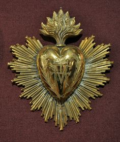Ex voto ( GOLD - hinged heart locket.  Some tin ones also have hinged hearts to house keepsakes. )
