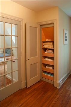 For a deep closet in which things tend to be shoved to the back and forgotten forever, install some rollout drawers like these. Keep the fronts labeled so you'll remember what's lurking in the back of the drawers.