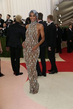 The 20 Best Metallic (and Very Futuristic) Met Gala Looks - The New York Times Bad Dresses, Wedding Dresses, Backstage, H&m Fashion, Met Gala Red Carpet, Sheer Clothing, Evolution Of Fashion, Vogue, Embellished Dress