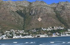 Gordons Bay with the GB and anchor on the Hottentots-Holland Mountain range… Virgin Atlantic, Cape Town South Africa, Beach Road, Volunteer Abroad, Wale, Lush Garden, Water Activities, Most Beautiful Cities, West Coast