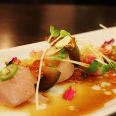 Crudo : Sea Bass, heirloom tomato, ikura, candiedquinoa, and lemon herb oil. Yum :) - Yelp