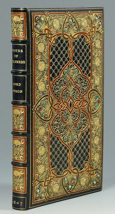 Hours of Idleness by Lord Byron - 1807 with early 20th century jewelled Cosway-style binding by Sangorski Sutcliffe, the interior containing miniature portraits of Lord Byron and his ancestral home, Newstead Abbey. Original silk and velvet lined leather bound case (via invaluable.com).