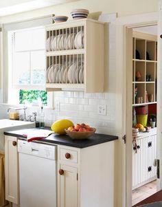 kitchen with plate rack, soapstone counters, subway tile backsplash