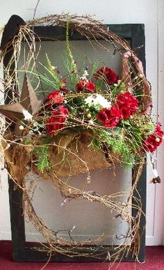 Old Prim Twiggy Door Decor...with a rusty star and flowers.
