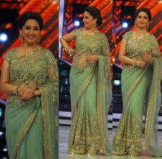 Bollywood Style Madhuri Dixit Net Saree in Aqua Green color Net Saree Designs, Saree Designs Party Wear, Sari Blouse Designs, Party Wear Sarees, Trendy Sarees, Stylish Sarees, Fancy Sarees, Bollywood Designer Sarees, Bollywood Saree
