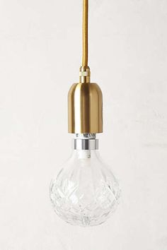 Anthropologie - Crystal Pendant Lamp - the price is ridiculous, but I bet I could do a hack with a plain bulb and spray paint the cord.