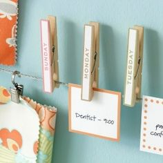 I might string a piece of twine on the shelf of my dorm desk and use clothes pins to hang up reminders/notes using scrapbook paper that I cut into small squares...love this idea!