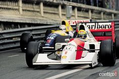Ayrton Senna - F1 World Champion in 88, 90 and 91. (Ayrton Senna and Nigel Mansell in this picture)
