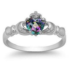 Claddagh ring- I have one similar to this...but a tiny green stone. This is sooo something I would love to have! ♡♡