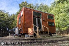 "A charming, modern tiny house on wheels titled ""The Little Leaf Project"". The 220 sq ft home is currently available for sale in Bloomington, IN."