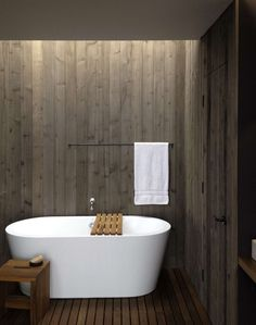 A wood-paneled bath overlooking the Puget Sound in Seattle by MW|Works Architecture.