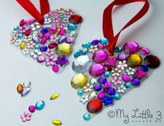 How to make a Jewelled Milk Bottle Sun Catcher  You will need  One 4 pint plastic milk bottle  Pair of scissors  Hole Puncher  Glue Stick  Acrylic Jewels (Sequins or glitter work nicely too)  Ribbon or thread for hanging  Method