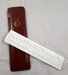 Diwa Slide Rule 601 Lear Aviation Products Leather Sleeve Small white plastic pocket slide rule in a leather case, Made in Denmark by Diwa