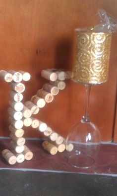 "Cork ""K"" & wine glass candle- for our wedding centerpieces."