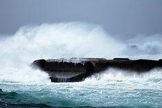 Bandon waves hitting the rocks in Bandon Oregon
