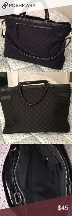 """💕HOST PICK 💕 Nylon laptop bag with leather trim Black quilted """"Victoria"""" nylon bag with leather trim from Banana Republic. Zip pocket on front, zip pocket and 2 slip pockets inside as well as a large accessory and cord pocket with snap closure. Adjustable shoulder strap and 2 leather wrapped handles. Banana Republic Bags Laptop Bags"""