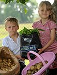Boy and girl with Grow Your Own Potatoes kit