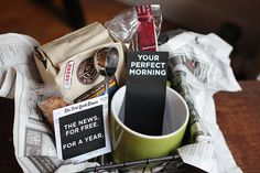 your perfect morning gift basket...mug, coffee beans, coffee spoon, biscotti, a subscription to a favorite newspaper plus a free printable gift tag
