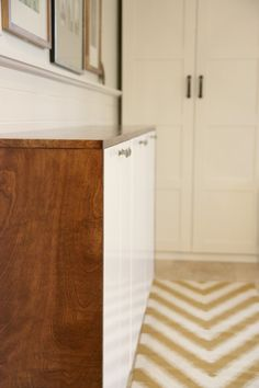 credenza built from ikea cabinets and stained wood.  Awesome idea. @Dana Curtis Miller