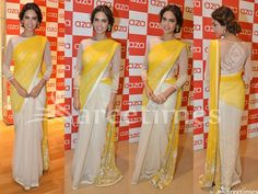 Bollywood actress Esha Gupta in beautiful white and yellow half and half saree at the launch of a new store by Aza in Bandra, Mumbai. She looked beautiful in net saree. Embellished patch work designs highlighted and white border. Paired with designer embellished full sleeves saree blouse for back. Embellished flowers highlighted on sleeves and blouse back.