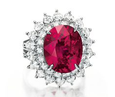 A ruby and diamond ring, by Cartier. Set with an oval-cut ruby, weighing…