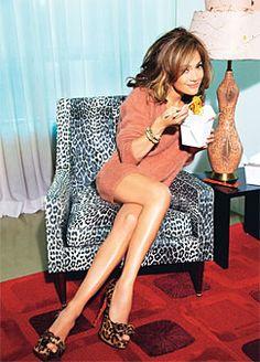 Jennifer Lopez sitting on the cutest animal print chair