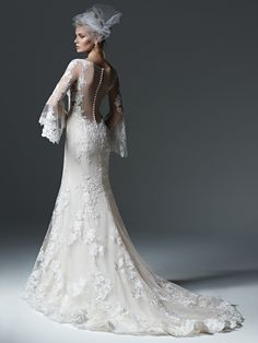 With an illusion back, and flared sleeves, the @maggiesottero Gabriella gown is the perfect mix of current and classic.