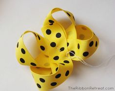 How to Make Bows: Twisted Boutique Bow {The Ribbon Retreat Blog} (uses cardboard template and is sewn)