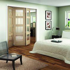 An Internal Oak Shaker 3 Door Room Fold & Slide Divider Clear Glazed 4 Light manufactured by Jeld-Wen RF193+0OK4GC,RF213+0OK4GC