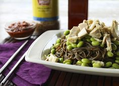 Lovely cold soba tossed lightly with a gently spicy sesame sauce, topped with edamame and flaked albacore tuna, and garnished with fried garlic; When served with additional chile garlic sauce, sesame oil, fried garlic and a bowl of pickled ginger we are talking about a serious treat.