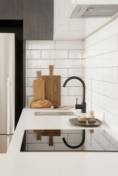 black faucet and subway tiles