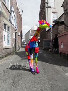 Meet Gerald, our yarn bombed giraffe.  He's in one of our windows and he's one of the 17 pieces stashed throughout Blackpool on the Summer of 2014 Yarnbomb Trail.  Gotta find the other 16. I know there's a Lock Ness Monster in the Library.  xx Susanne from Johnson's in Blackpool.