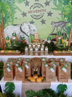 Dessert table and backdrop at a safari birthday party! See more party planning ideas at CatchMyParty.com!