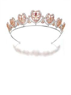 A Pink Diamond Tiara by Garrard. Pink diamond, diamond, platinum and 18k pink gold. Signed. (via Sotheby's 2008)