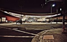 Beverly Hills Gas Station by Barbara Parkins Printed on Giclée Hahnemühle Pearl  California, USA. 2019  In Beverly Hills there is a very cool looking gas station. Art deco in design. As I walked across the street and loved the dark street lines and curved walkway leading to that neon lit gas station.   Colour photograph printed on premium quality photographic paper.  Photographer: Barbara Parkins. Photography Gallery, Street Photography, Art Photography, Female Photographers, California Usa, Gas Station, Neon Lighting, Walkway, Beverly Hills
