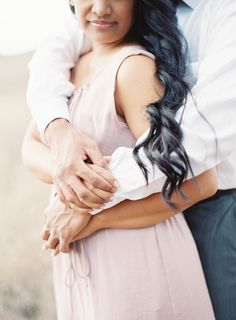 Nature-filled summer e-sesh: http://www.stylemepretty.com/california-weddings/coto-de-caza/2016/07/02/the-sweetest-sunskissed-engagement-session-ever/ | Photography: Sposto Photography - http://spostophotography.com/
