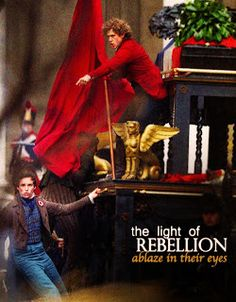 Les Mis (2012) | Movie Poster: The Light of Rebellion Ablaze in Their Eyes. Eddie Redmayne (Marius) and Aaron Tveit (Enjorlas) in Les Misérables.